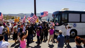 US protesters block the arrival of immigrant detainees who were scheduled to be processed at the Murrieta Border Patrol station in California. – courtesy of NPR